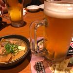 つぼ八 - 生ビールとお通しの煮込み