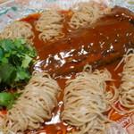 69139940 - アイナメ豆板醤ソースに山椒の入った麺を添えて