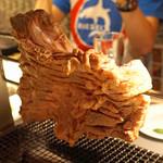 中国料理 喜羊門 - 羊の背中焼き