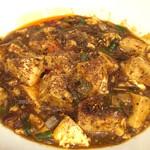 たんびに亭 - 山椒をかけた麻婆豆腐