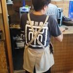 澤田さんの後ろ姿