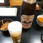 71094057 - 瓶ビールとお通しの揚げそば