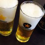 山東 - ビール(大瓶) @600円 サッポロ黒ラベルはとても淡白でした。グラスに水滴がついていたのはご愛嬌?