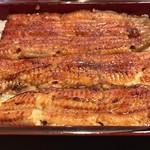 71481468 - お重箱から桜                       桜は中型サイズの鰻が一匹分入っています。残念ながら養殖。天然鰻は、お店に在庫を確認して注文の必要があります。