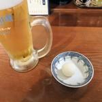 71742285 - 生ビールと大根おろし