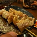 ことぶき焼肉 - 豚足串焼き