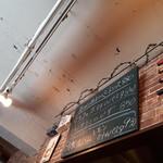 オステリア ピッカンテ ウノ - 店内のボード