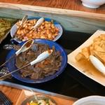 72276868 - フワフワの卵焼きに、コンニャクなどのお惣菜。