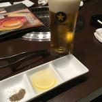 清江苑 - 生ビール  (サッポロ黒ラベル)