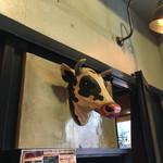 Red Rock - 入り口の上に牛さんが...