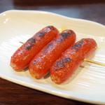 大衆酒場 したぢ屋 - 赤ウィンナー串焼(100円・外税)