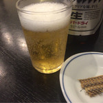 72708457 - 瓶ビール大と骨煎餅(煎餅はビールの突き出し)