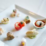 Ristorante AMRIT - 料理写真:好評の華やかな一皿【彩り前菜9種の盛り合わせ】