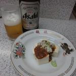 72772871 - 瓶ビール(大瓶)と味噌とうふ