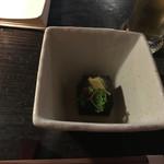 72903219 - お通しの黒ごま豆腐