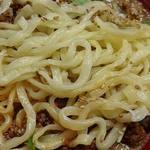 金蠍 - 金蠍 @神谷町 汁なし金胡麻担担麺に使われる加水率高めでモチモチ食感の縮れ平打ち太麺