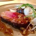 73103871 - イベリコ豚肩ロースのロースト                       柔らかいお肉と甘酸っぱいソースが絶妙〜