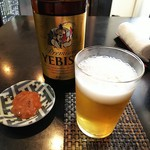 73129732 - 恵比寿瓶ビールとお通しのイカの塩辛