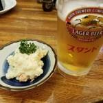 73284605 - ポテトサラダと生ビール中ジョッキ