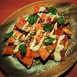 """フレーバージョイント - メキシコのおじや的存在!? """"チラキレス"""" コーンチップスを熱々のサルサと絡めたしんなり、さっくり食感が美味しい1品!おつまみやシメにもGOOD!"""