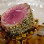 イヴォワール - 仔羊 鞍下肉のロティ 香草風味 グリーンペッパーソース