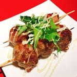 百坊 - 料理写真:名物 プチトマトの肉巻き 他では真似できないプチッと食感!