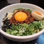73629177 - 台湾まぜそば 麺少め 味玉半分付き(780円)※食後の追飯(少量のご飯)は無料です。