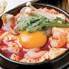 ジャンモ - 料理写真:柔らかい豆腐とジャンモ特製タデキ(辛みそ)に魚介類や卵などを一緒に煮込んだ純豆腐チゲ