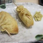 73816232 - お稲荷さんの中はゴマ豆腐です