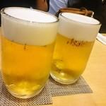 立呑み さいごう - 生ビール(左)と生ホッピー(右)