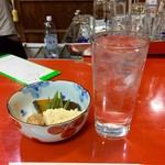 スタンドアサヒ - 料理写真:小鉢と芋焼酎の水割り