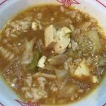 蒙古タンメン中本 - 蒙古タンメンの残りスープに半ライスの残りを入れて「おじや」にして食べてみました。