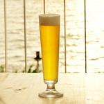 ハンモックカフェ ラ・イスラ - 名水に選ばれた玉泉洞の地下水、コーラルウオーターから作ったサンゴビール。インターナショナルビアカップ受賞の南都酒造自慢の地ビールです。 当店はその生ビールが飲める貴重なお店となっています。素晴らしい香りをお楽しみください。