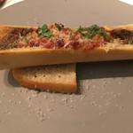74481259 - トリッパと豚足、骨髄のトマト煮込みのオーブン焼き