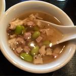 74695570 - スープは豆や中国ハムがどろごろ