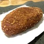 コシニール ベーカリーカフェ - 料理写真:ポークカレーパン
