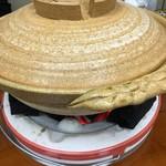 得仙 - 炭の上に置かれた鍋