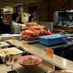 リラッサ - 蟹大漁盛りに群がる