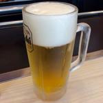 てっぱん源治家 - 「生ビール」(中390円税込)。
