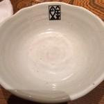目黒川魚金 - 魚金マーク