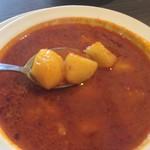 ネパール民族料理 アーガン - 辛味ソースで煮た単なるじゃがいもなんじゃけど・・。