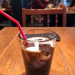 ラ ボデガ - 自家製サルシッチャのロースト 秋茄子のグラタン添え(アイスコーヒー)