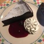76450786 - チョコレートケーキ(ラズベリーソース)