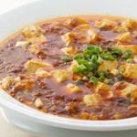 南国亭 - 料理写真:四川風スパイスの効いたマーボー豆腐。 ヤミツキになるリピーター続出! 自宅では味わえない本場の味をご堪能ください。
