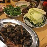 まんとく - 料理写真:地鶏のもも焼き