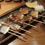 炉端 灰干し でぶろく魚類 - 灰干し魚の串焼きです