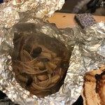 磯丸水産 - イカときのこのホイール焼き 味はイカのワタでした。
