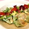 ポルチーニ茸と生ハムの煮込みソースの自家製パパルデッレ