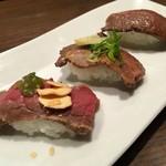 肉屋の肉バル TAJIMAYA - 炙り寿司食べ比べ