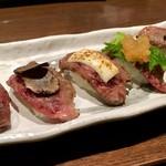 肉屋の肉バル TAJIMAYA - 炙り寿司5貫(トッピング付き)